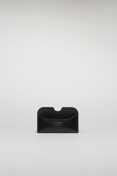 Acne Studios Elmas shiny black cardholder is crafted from high-shine leather and features three card slots with a gold logo stamp at the front.