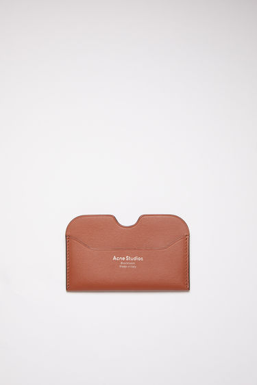 Acne Studios almond brown card holder is made of soft grained leather with a silver logo stamp.