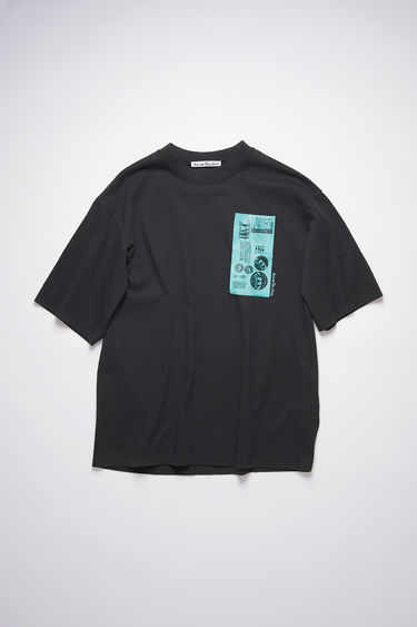 Acne Studios black crew neck t-shirt is made of cotton with a print at the chest, in collaboration with Dizonord, a record store in Paris, France.