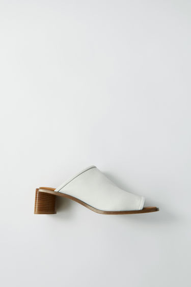 Acne Studios white/beige comfortable leather slide sandals.