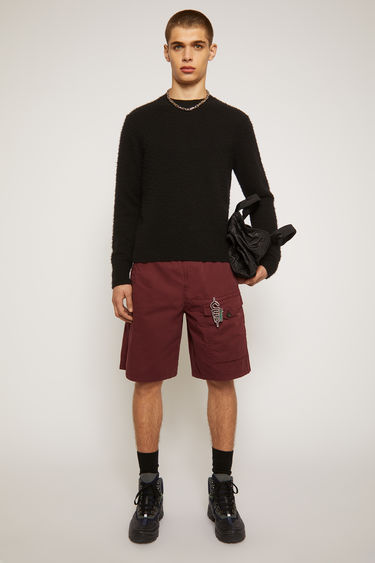 Acne Studios burgundy shorts are made from cotton that's garment-dyed to create light fading at the seams. They're cut in a straight shape that drapes loosely over the leg and finished with an elasticated drawstring waistband and a utilitarian flap pocket.