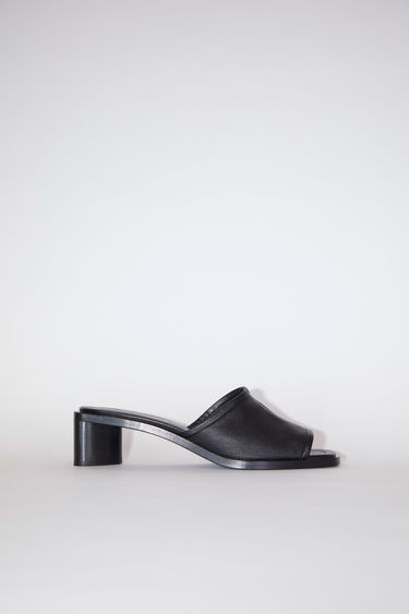 Acne Studios black/black slip-on sandals are made of leather with open toes and block heels.