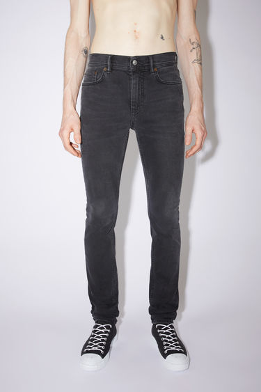 Acne Studios used black jeans are made from comfort stretch denim with a mid rise and a skinny leg.