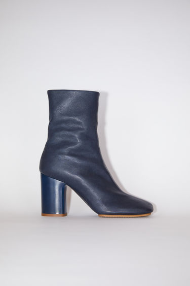 Acne Studios blue grain leather boots have square toes and chunky heels.