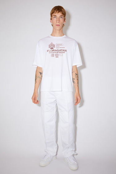 Acne Studios optic white relaxed fit t-shirt is made of organic cotton with a ribbed crew neck and distressed print.