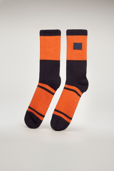 Acne Studios blue multicolour striped socks are rib-knitted from cotton-blend yarns, with a towelling finish footbed and finished with an embroidered face patch.