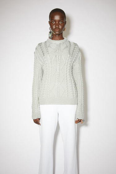Acne Studios silver grey chunky cable knit sweater is made of nylon with a fitted silhouette.