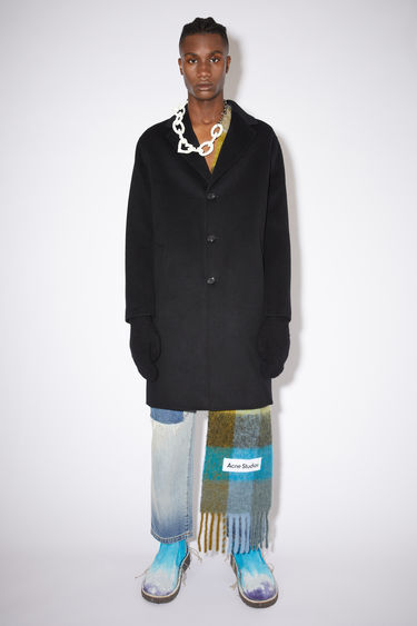 Acne Studios black double face coat is made of wool with two side pockets.