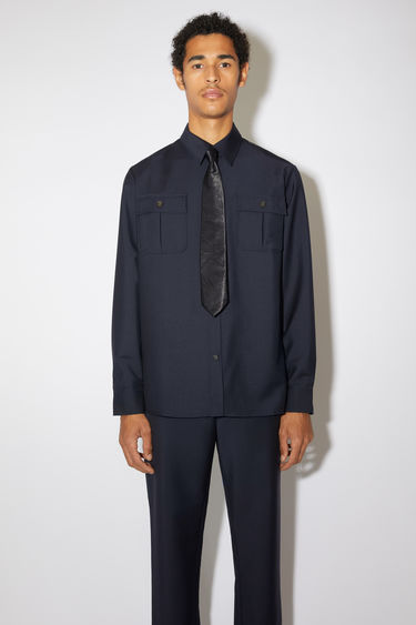 Acne Studios navy shirt is made from wool and mohair that has a subtle lustrous sheen. It's cut for a relaxed silhouette and has a straight hem and a pair of buttoned patch pockets at the chest.