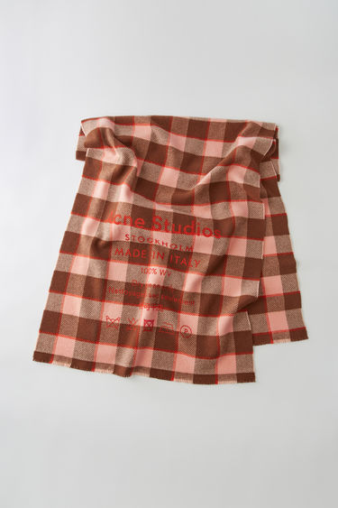 Acne Studios brown/pink scarf is patterned with a check design and features a screen printed Acne Studios logo and care label.