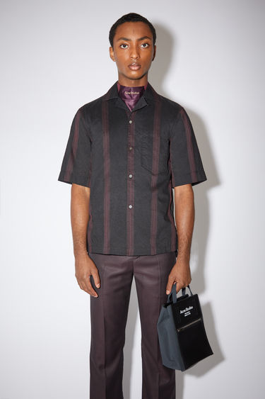 Acne Studios black/maroon red casual short sleeve shirt is made of a striped cotton blend with a classic fit.