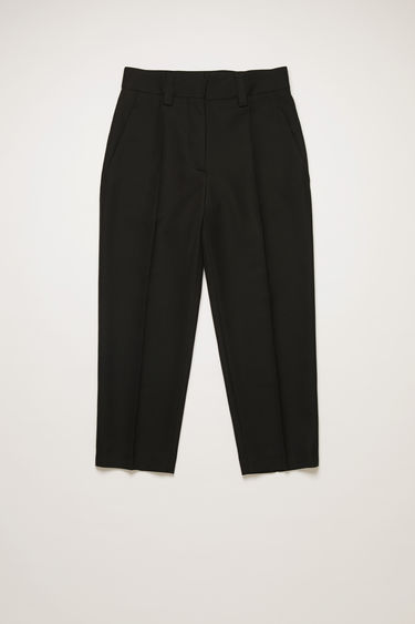 Acne Studios black wool-blend trousers are cut to sit high on the waist and shaped with a tapered silhouette.