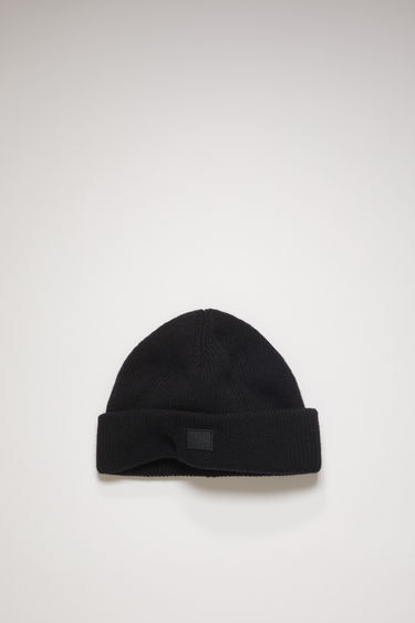 Acne Studios black beanie is knitted with wool and lycra for a closer fit and accented with a tonal face-embroidered patch on front.