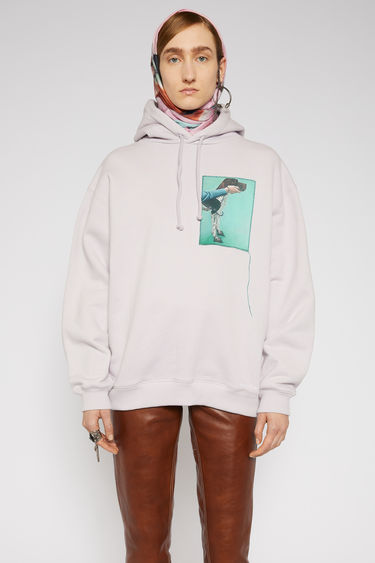 Acne Studios light purple hooded sweatshirt is crafted from organic cotton to a relaxed silhouette with dropped shoulders and adorned with a printed patch, featuring a prize dog created by Britsh artist Lydia Blakeley.