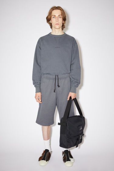 Acne Studios slate grey relaxed fit shorts are made of cotton with an elasticised waistband.