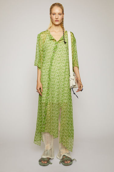Acne Studios fern green dress is crafted from crinkled silk chiffon and patterned with a floral print reminiscent of vintage wallpapers. It's cut to an asymmetric silhouette that drapes diagonally across the front, then finished with a button-down closure.