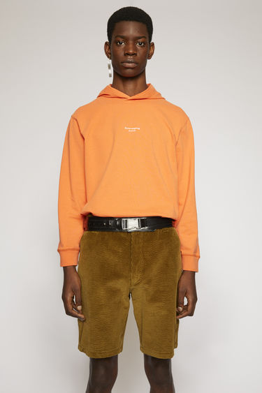 Acne Studios mandarin orange hooded sweatshirt is crafted to a boxy fit from cotton jersey and then finished with a reversed logo across the chest.