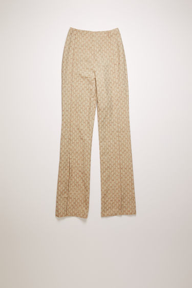 Acne Studios peach orange trousers are crafted from floral jacquard that's shaped to sit on the waist with slim, flared legs and then finished with stitched folds through the front.