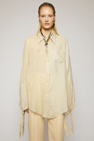 Acne Studios cream beige shirt is crafted from lightweight linen with a multi-tonal appearance and features knotted cuffs and raw edges along the hem and collar.