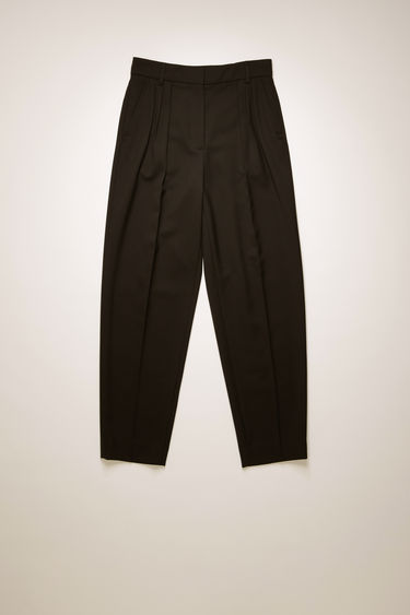 Acne Studios black wool-blend trousers are cut to a tapered fit with a mid-rise waist and defined with sharp knife pleats and pressed creases.
