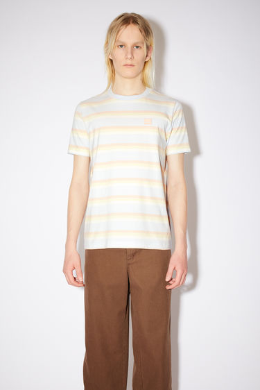 Acne Studios powder blue cotton jersey t-shirt features pastel stripes and an embroidered face patch.
