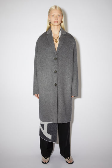 Acne Studios grey melange coat is tailored from a brushed alpaca and wool blend to a cocoon silhouette with slim, notch lapels.