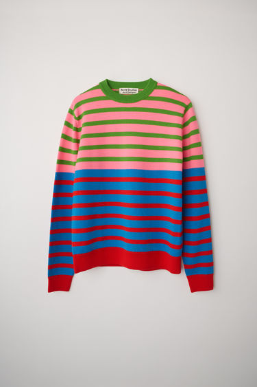 Acne Studios launches an exclusive range with Swedish artist Jacob Dahlgren. As part of the collaboration, the blue multi sweater is finely knitted from wool and patterned with horizontal stripes.