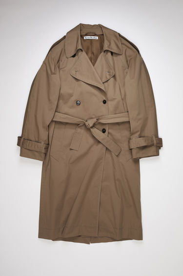 Acne Studios light brown lined trench coat with decorative topstiching is made of cotton with a slight stretch and has a relaxed fit.