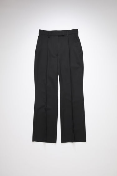 Acne Studios black suit trousers are made of a wool blend with a high waisted, straight leg fit and cropped, flared hems.