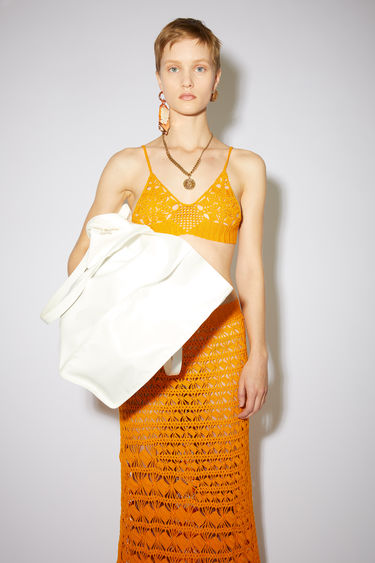 Acne Studios orange crochet bra top is made of cotton.