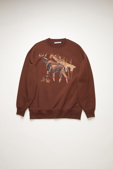 Acne Studios walnut brown sweatshirt is made from organically grown cotton and features a print of okapi overlaid with a tonal logo. It's cut for a relaxed silhouette with a ribbed round neck and dropped sleeves.With every purchase of this item Acne Studios makes a donation towards the Okapi Conservation project, a protection organisation that helps protect critically endangered species and their habitats.