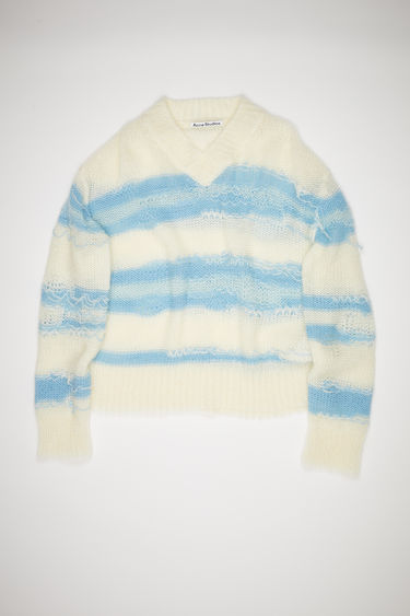 Acne Studios white/blue v-neck sweater has textured, irregular stripes and a short, relaxed fit.