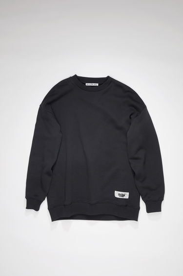 Acne Studios black crew neck sweatshirt is made of a cotton blend with an Acne Studios label on the lower front.