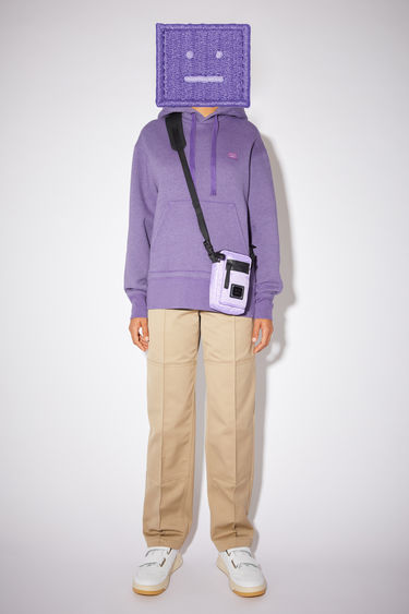 Acne Studios electric purple hooded sweatshirt is made of organic cotton with a face logo patch and ribbed details.