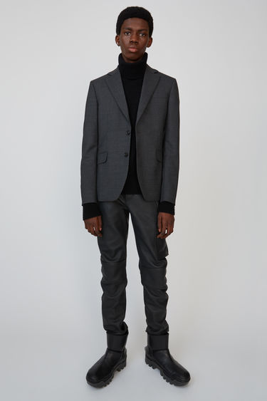 Acne Studios dark grey melange wool suit jacket is tailored to a classic straight silhouette with welt chest pocket, flap hip pockets, and a double back vent.