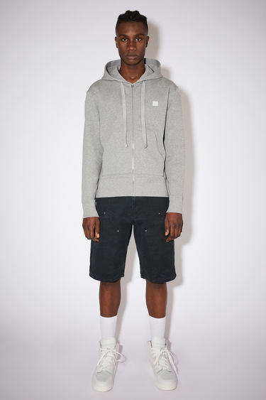 Acne Studios light grey melange hooded sweatshirt is made of organic cotton with a face logo patch and ribbed details.