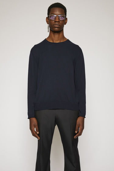 Acne Studios navy blue sweater is knitted from soft Japanese cotton and features rolled edges on the cuffs, hem and neck.