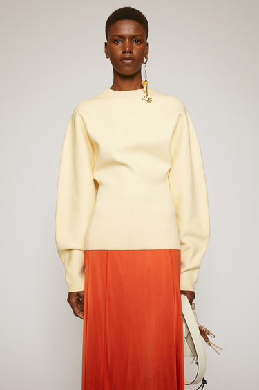 Acne Studios off white sweater is crafted from a double faced wool blend knit. It's shaped to a form-skimming fit with a round neckline, and is offset with blouson sleeves.