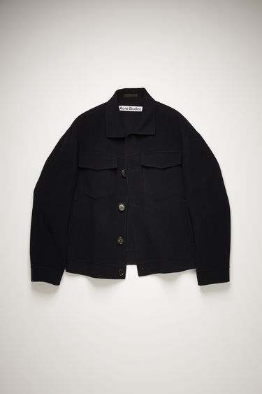 Acne Studios navy jacket is crafted from double-faced wool twill to a boxy silhouette with dropped shoulders and features two buttoned chest pockets, side pockets and point collar.