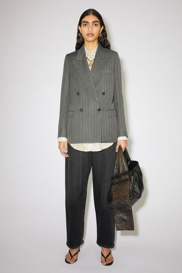 Acne Studios grey/black double-breasted suit jacket is made of a striped linen blend with a classic fit.
