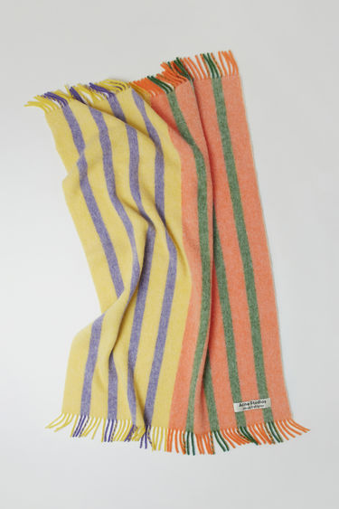 Acne Studios launches an exclusive range with Swedish artist Jacob Dahlgren. As part of the collaboration, the yellow multi striped blanket is finely knitted from brushed wool and trimmed with fringed edges.