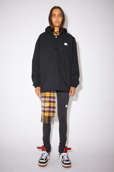 Acne Studios black hooded anorak jacket is made of a structured polyethylene twill with retro styling.