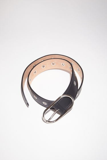 Acne Studios black leather belt is studded with silver-tone metal eyelets along the length and has a discreet engraved logo on the oval-shaped buckle.