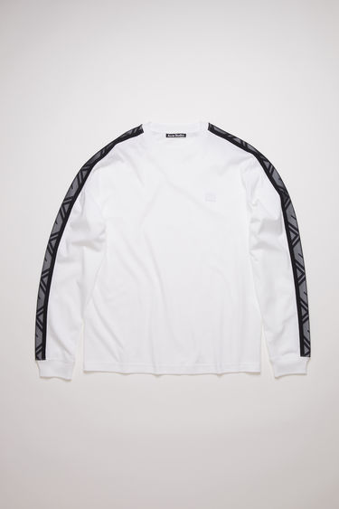 Acne Studios optic white long sleeve t-shirt is made of organic cotton with a face logo patch and 3D woven face logo tape on the sleeves.