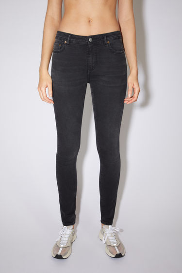 Acne Studios used black jeans are made from super stretch denim with a mid rise and a skinny leg.