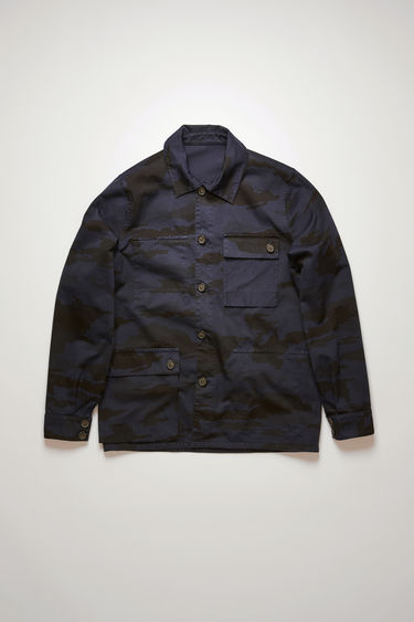 Acne Studios navy reversible chore jacket is cut from garment-dyed cotton that has a camouflage print on one side and solid tone on the other. It's crafted with a point collar, buttoned flap pockets and five-button closure.