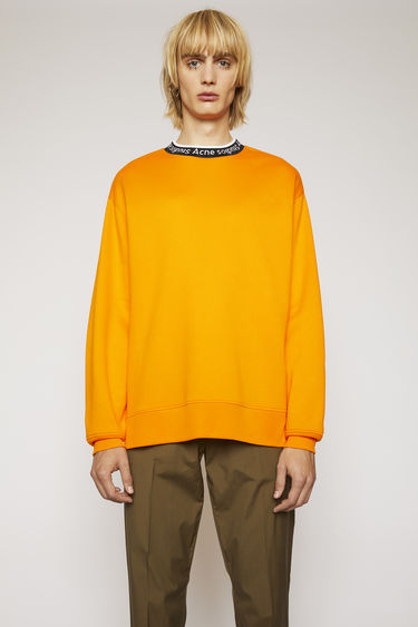 Acne Studios carrot orange sweatshirt is crafted to an oversized fit from technical brushed jersey and detailed with a ribbed logo-neck trim.