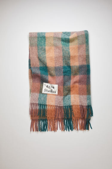 Acne Studios teal blue/lilac fringed blanket is crafted from soft alpaca, wool and mohair and has an upscaled logo label patch stitched at the corner.