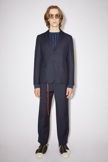 Acne Studios navy suit jacket is cut from lightweight wool and mohair-blend to a single-breasted silhouette and has notch lapels, front flap pockets and unstructured shoulders.