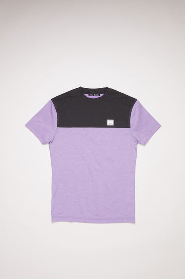 Acne Studios iris purple colour block t-shirt is made of lightweight technical jersey with a reflective face logo at the chest.